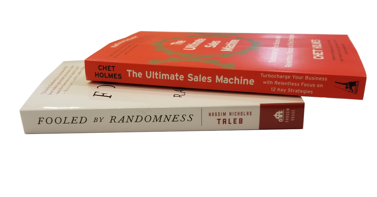 ultimate sales machine paperback casually sitting on top of fooled by randomness paperback